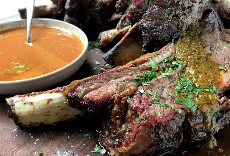 Image of Wood-fired Rotisserie Beef Ribs with Smoky Red Chimichurri