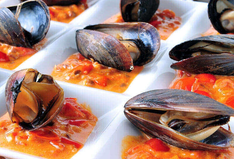 Image of Wood-Fired Mussels with Rustic Olive and Tomato Sauce