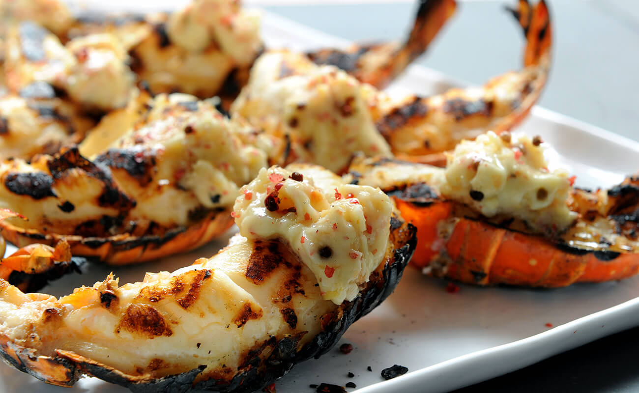 Image of Grilled Lobster Tails with Ginger Grapefruit and Pink Peppercorn Butter